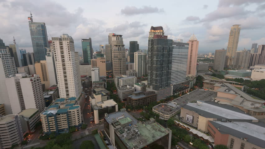 Manila, Philippines - Aug 8, 2015: Metro Manila Day to Night timelapse. Elevated, night view of Makati, one of the most developed business district of Metro Manila.