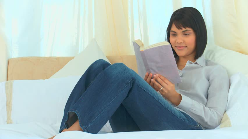 Relaxed asian woman reading a book in the bedroom - HD stock footage clip