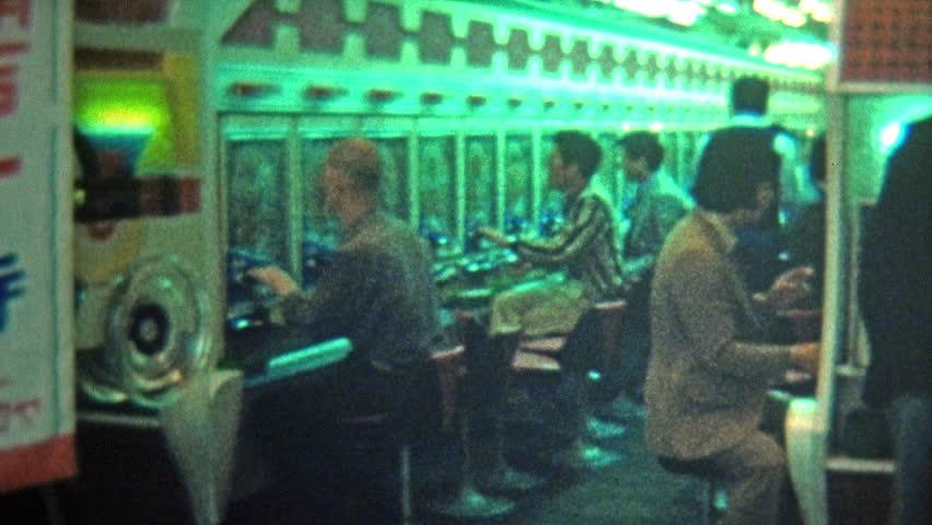 TOKYO, JAPAN -1972: Pachinko Japanese pinball machines crowd a downtown parlor.