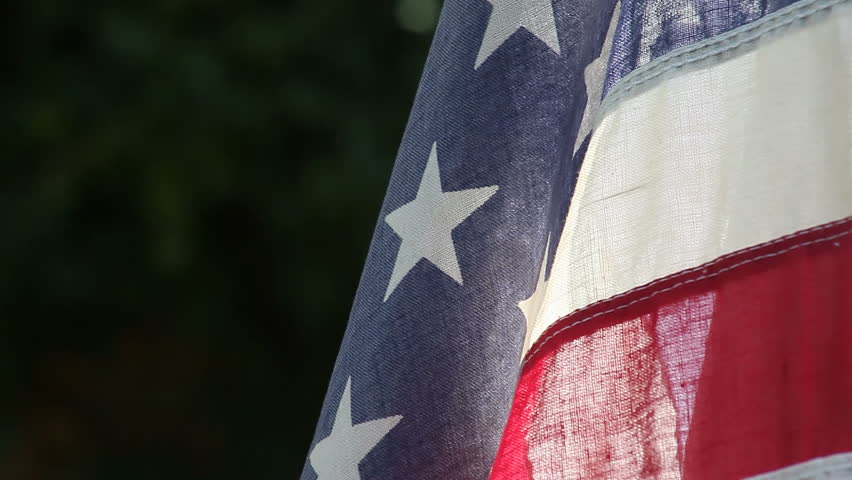 close up view of an old American flag with copy space on the left - HD stock video clip