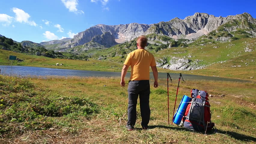 tourist man in mountain with backpack