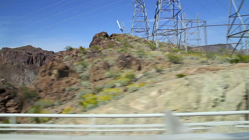 Driving past the Hoover Dam. - HD stock video clip