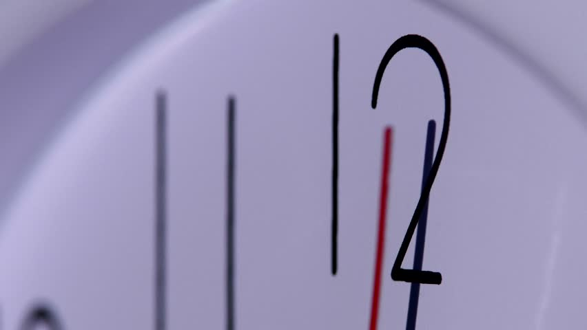 close up of an office clock. office close up of an white office clock on white background with clipping path