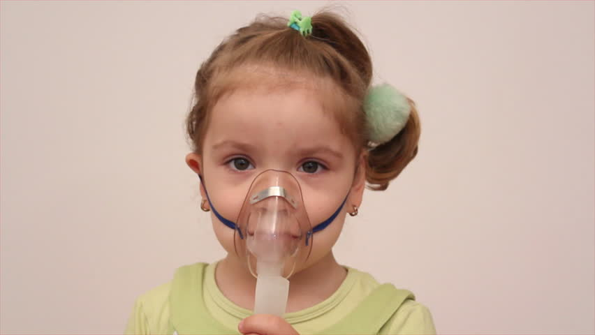 child with inhalation mask - HD stock video clip