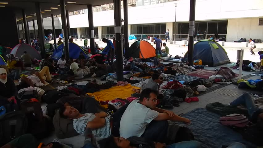 BUDAPEST - SEPTEMBER 1 : War refugees at the Keleti Railway Station on 1 September 2015 in Budapest, Hungary. Refugees are arriving constantly to Hungary on the way to Germany.