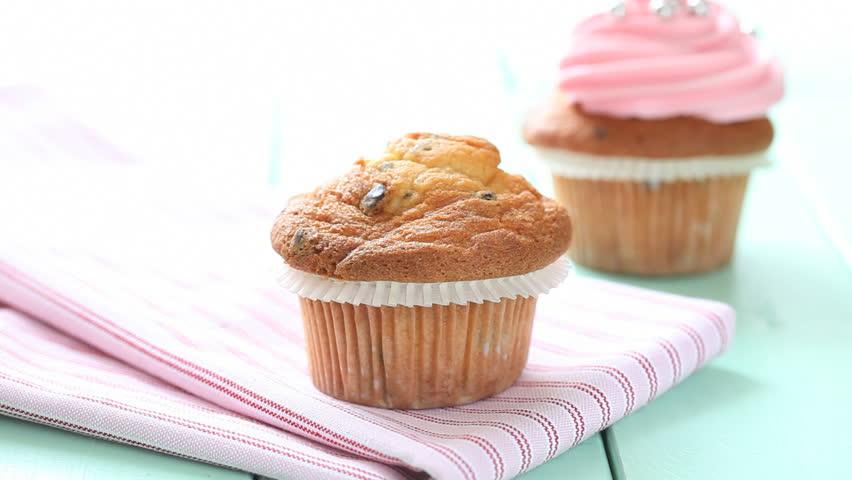 placing chocolate icing on cupcake #1150807