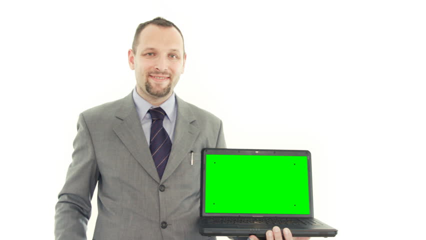 Businessman presenting laptop with green screen and tracking points, isolated on white - HD stock footage clip