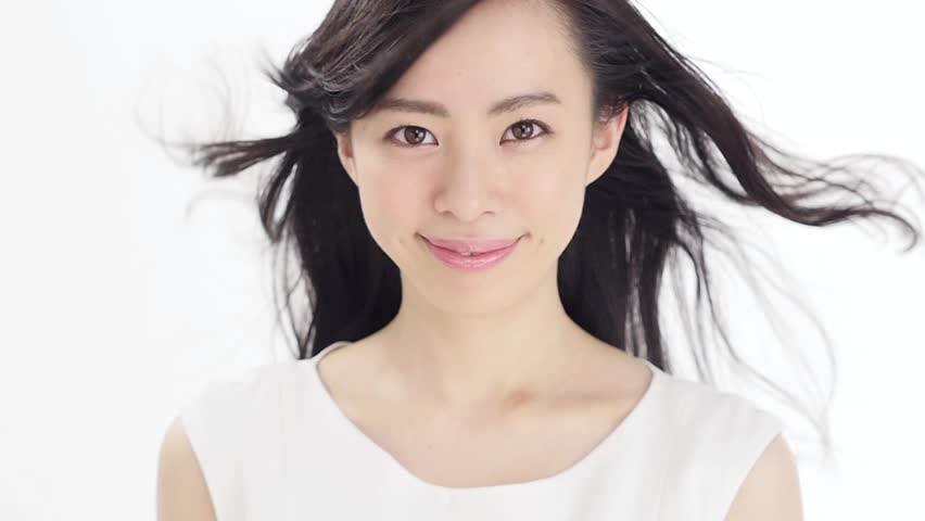 attractive asian woman haircare image on white background - HD stock footage clip