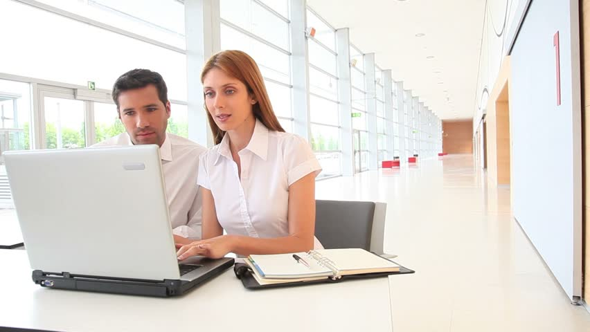 Business people in front of laptop computer - HD stock video clip