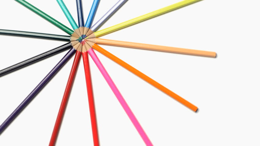 Color pencils turning on themselves on a white background - HD stock footage clip