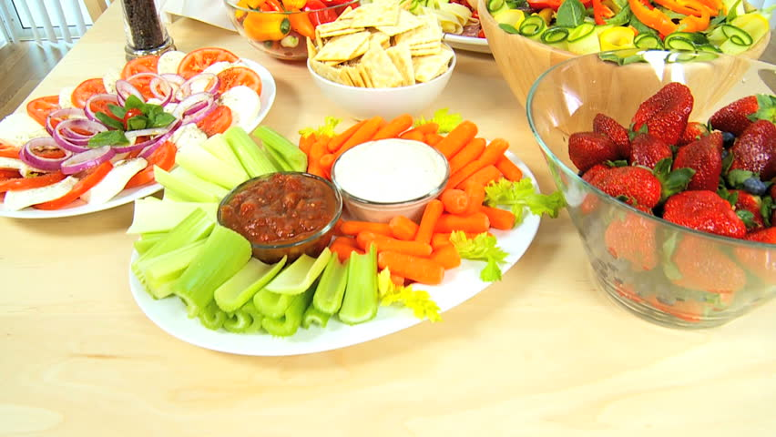 Table laid with delicious fresh fruit & vegetables as part of a healthy lifestyle diet - HD stock video clip