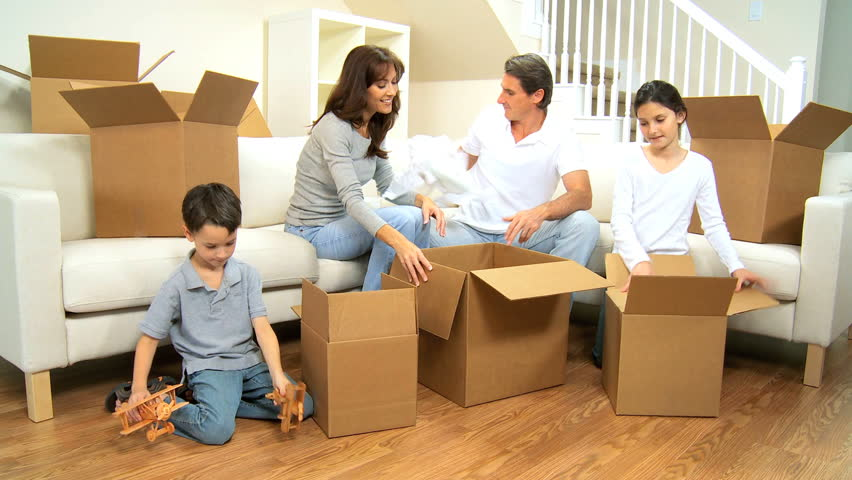 Little boy with toy planes helping his family pack up for Moving home pictures
