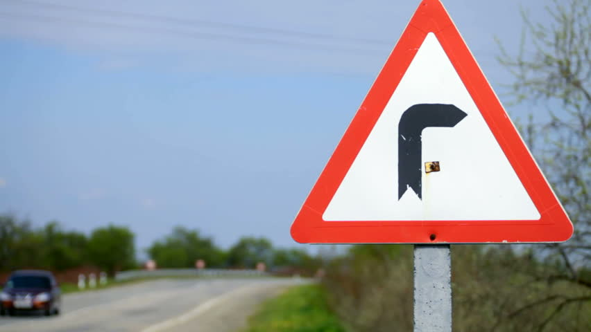 European Sign Warning of a curve in the road - HD stock video clip