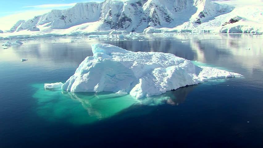 iceberg in full sunshine in antarctica