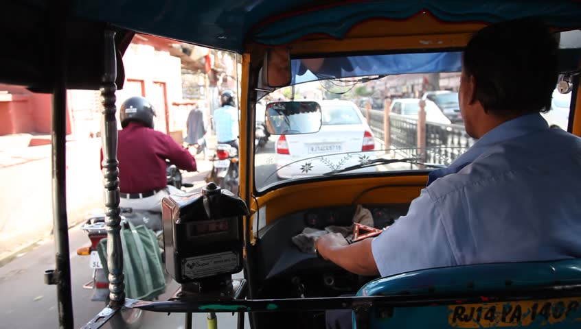 JAIPUR, INDIA - MAY 19: View of street from the back of a rickshaw taxi (auto rickshaw), May 19, 2010, Jaipur, India. Auto rickshaws are common all over India, and provide cheap and efficient transportation.