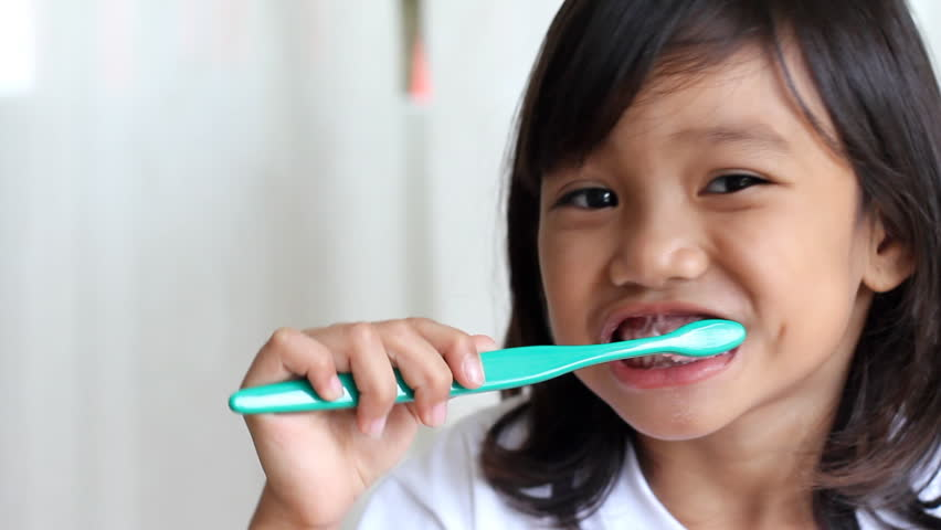 young kid brushing her teeth - HD stock footage clip