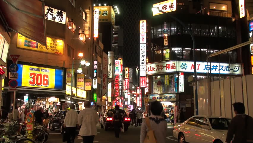 TOKYO, JAPAN - OCTOBER 5: Night traffic on a busy Shinjuku commercial street, October 5, 2008, Tokyo, Japan. Shinjuku is a major commercial and administrative center, housing the busiest train station in the world (Shinjuku Station). - HD stock video clip