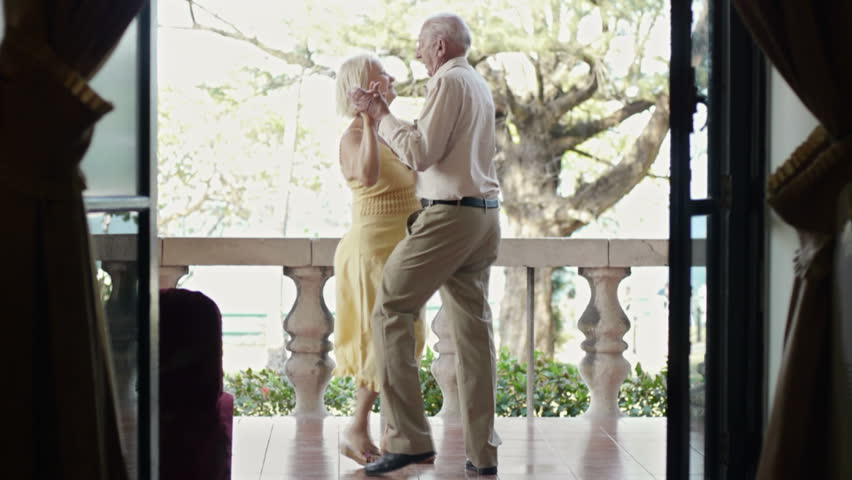 Old people and dance, elderly man and woman as dancers, senior caucasian couple on vacation, dancing on terrace in hotel during holidays