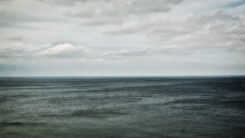 Calm Ocean horizon HD stock footage. Beautiful shot of the North sea with blue skies and seaweed floating on the surface. ProRes. Colour Graded.