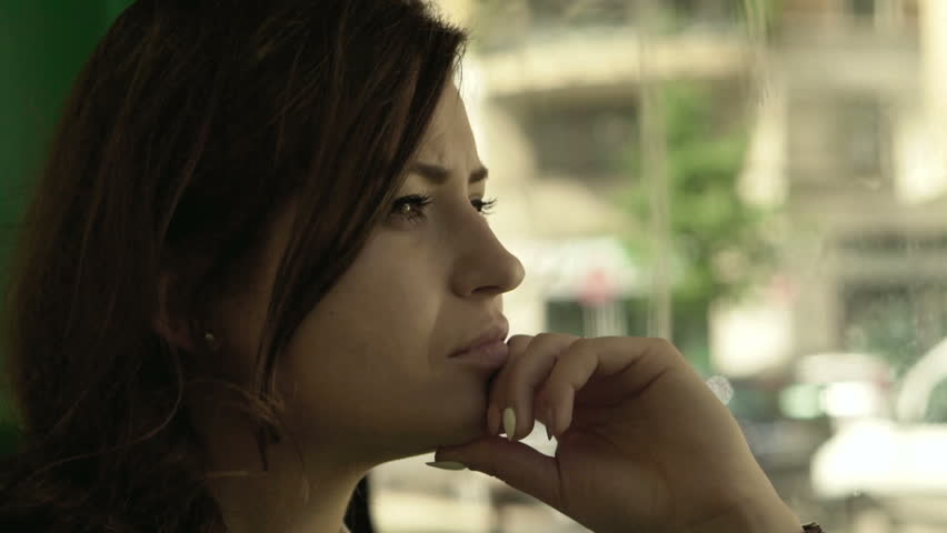 Pensive girl traveling by bus in the city, steadycam shot