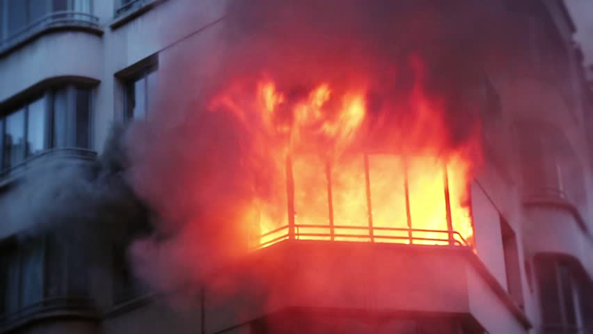 Apartment in Paris explodes and it's involved in flames and smoke. 4 OCTOBER 2015 - PARIS, FRANCE; An apartment explodes and catches fire, breaking all the windows and killing one person.