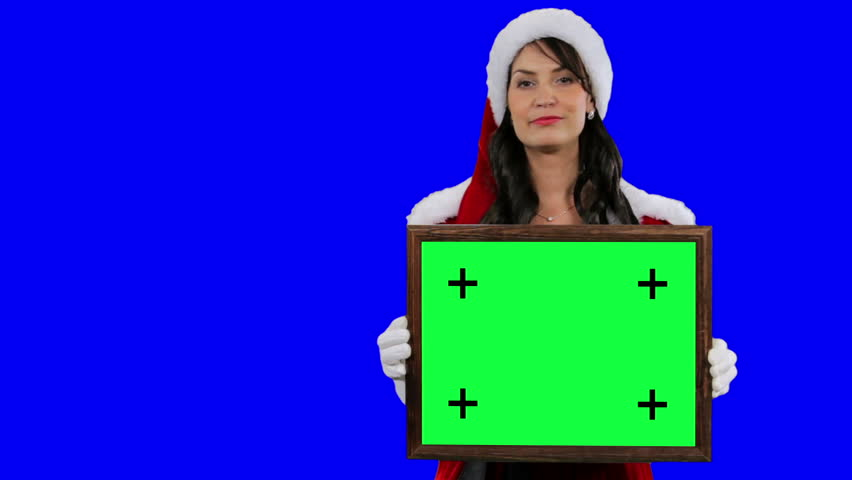 Sexy Santa's helper demonstrates frame for tracking chroma key (green screen). Sexy Santa girl holds the frame in her hands closeup