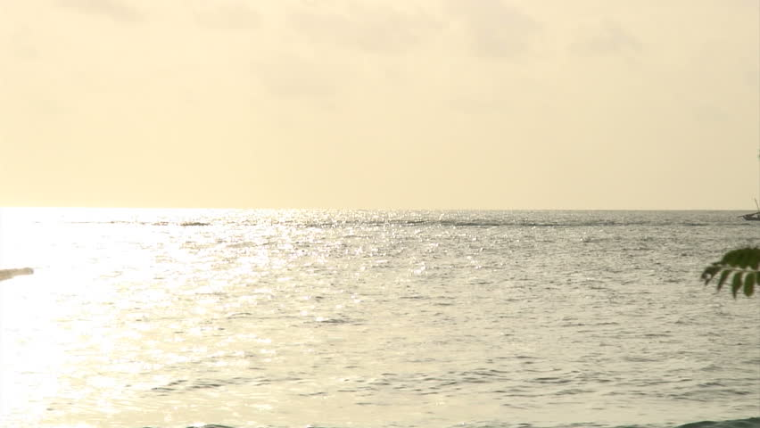 African fishing boat sets out at sunrise - HD stock video clip