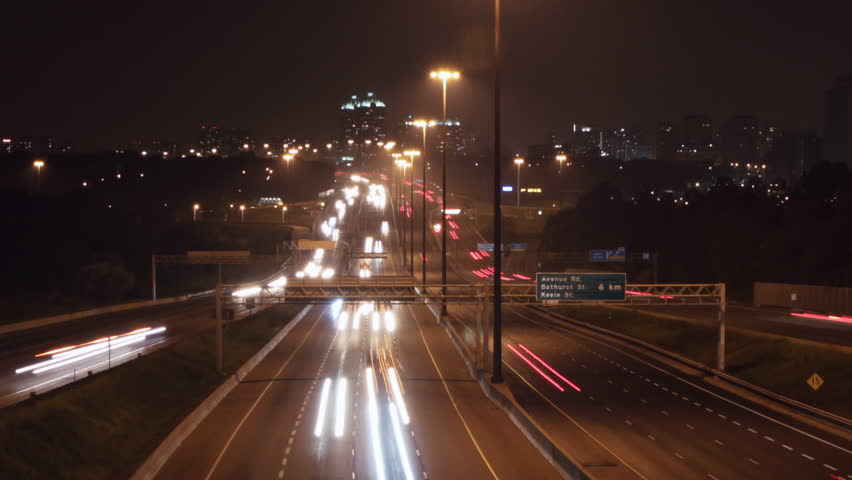 Timelapse of Hwy 401 in Toronto at night. Zooming out.  - HD stock footage clip