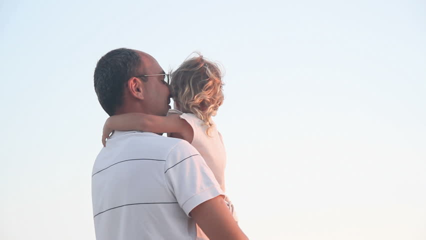father and daughter outdoors