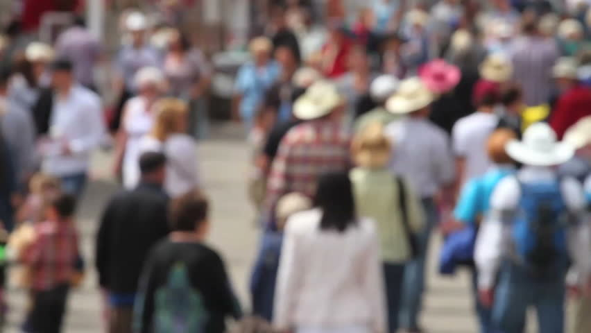 Crowd of people walking in soft focus - HD stock footage clip