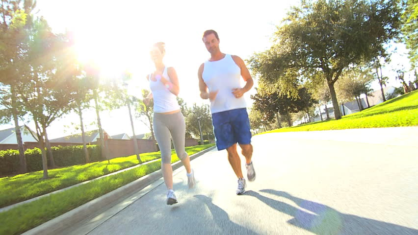 Active caucasian couple jogging to keep fit