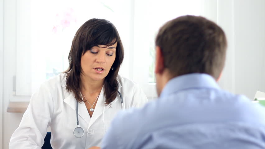 Female doctor telling bad news to male patient - HD stock video clip