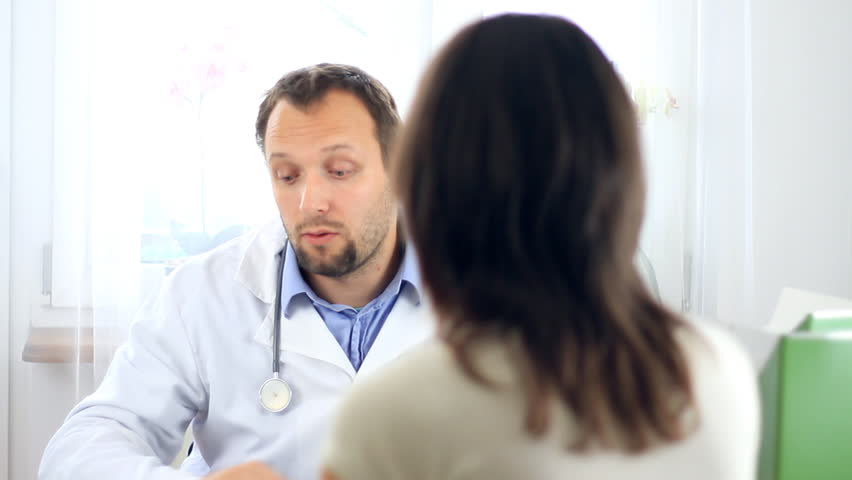 Male doctor recommending medications to female patient - HD stock video clip