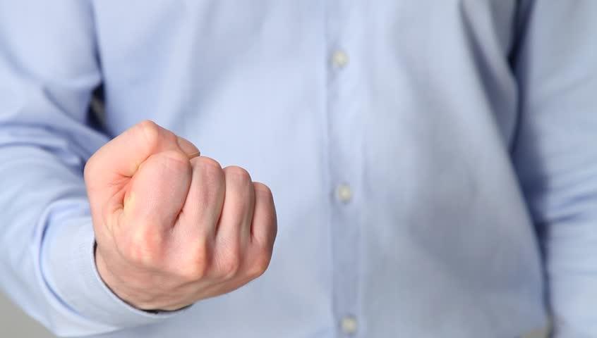 Unrecognizable businessman showing a strong fist