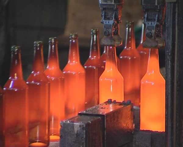Bottles Already Bloated From Glass Moves On The Platform. Glass ...