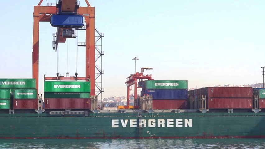 ISTANBUL - MAY 16: Evergreen Container Ship shot while gantry lifts up a