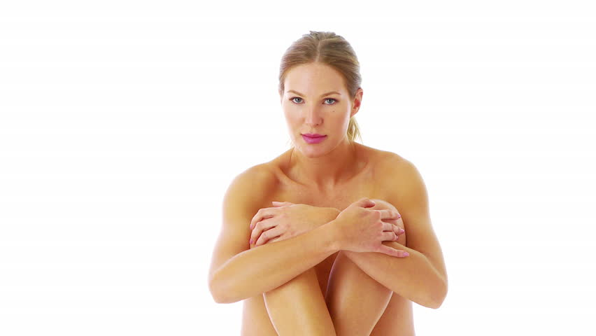 Nude woman sitting with legs drawn up - HD stock video clip
