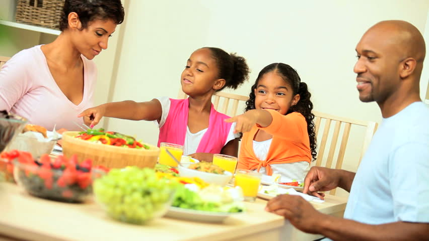 Young african american family sharing a healthy lunch together at home  - HD stock video clip