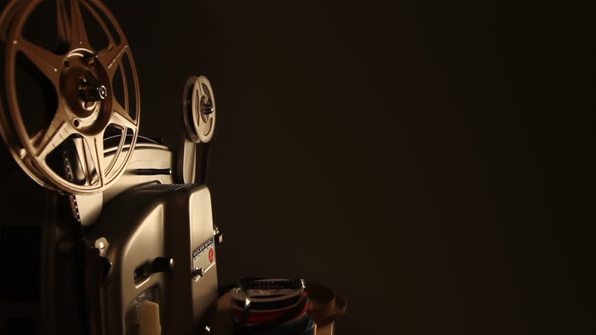 An antique 8mm film projector  projects a blank movie with a dust and hair texture, lifted from real 8mm film. Includes projector audio. - HD stock footage clip