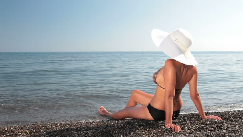 woman enjoying her vacation on a  beach  - HD stock footage clip