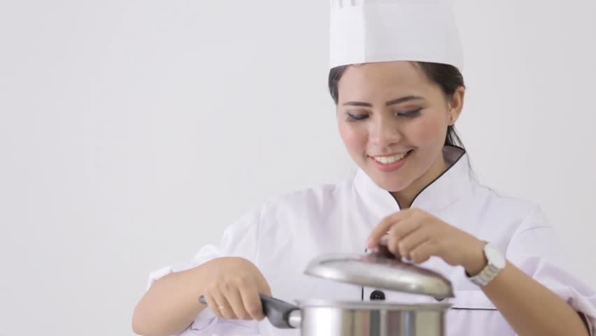 happy young female chef smell on her cooking - HD stock footage clip