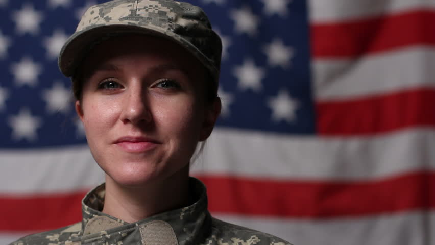 Female soldier in front of US flag - HD stock video clip
