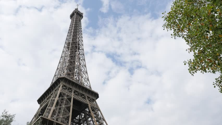 eiffel tower in front of cloudy sky paris france 4k 2160p 30fps ultrahd footage beautiful. Black Bedroom Furniture Sets. Home Design Ideas