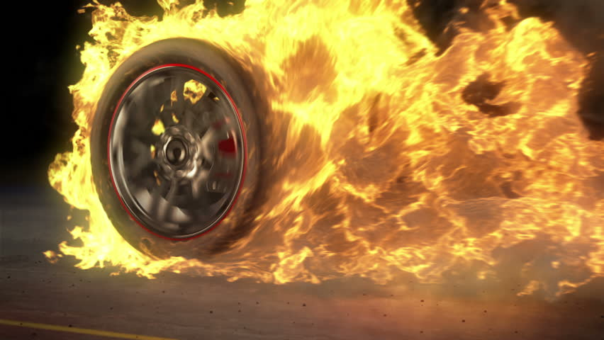 tire Burnout on asphalt, creates lots of fire & heat seamless loop - HD stock footage clip