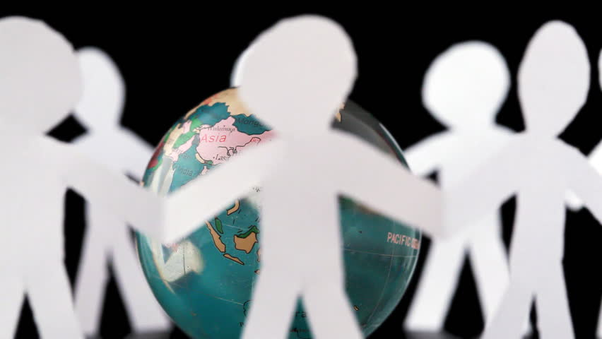 paper people stand holding hands and rotates around transparent globe on black background