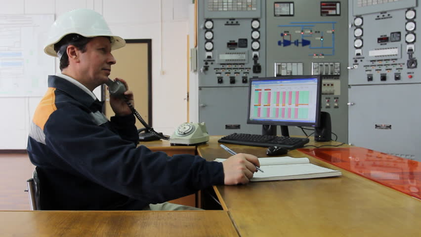 engineer talks with someone by phone and writes data to working log - HD stock footage clip