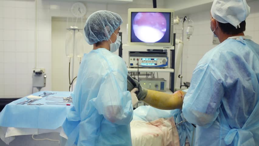 MOSCOW - SEP 1, 2015: Doctors conduct endoscopy surgery on knee joint in Center of endosurgical and lithotripsy