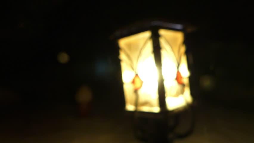 Street lamp at the night in snowy weather. Focusing. - HD stock footage clip