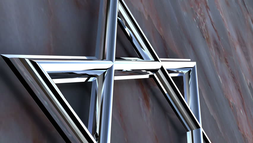 A chrome star of David in front of a  stone wall.   Shutterstock HD Video #1389442