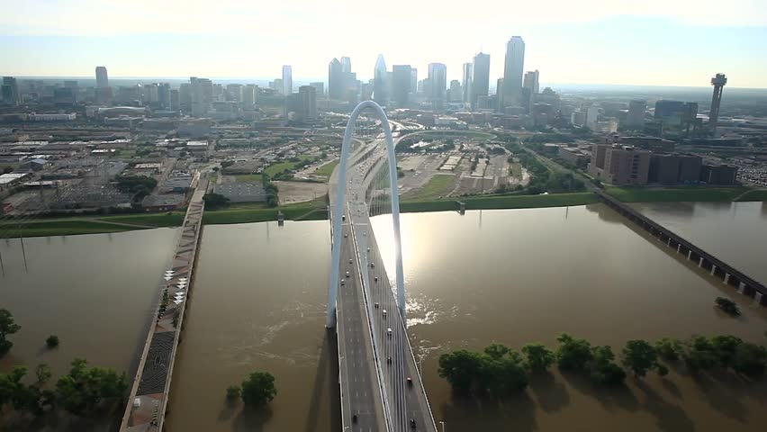 Aerial flyby over the Margaret Hunt Hill Bridge near downtown Dallas Texas. Shot establishes vertically looking down on the bridge and then dollies backwards revealing the upper span of the bridge.
